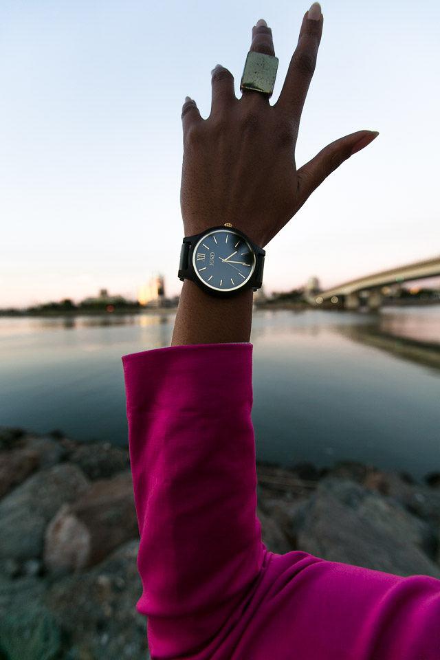 woman's arm wearing a watch