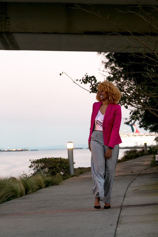 woman wearing a pink blazer work outfit idea