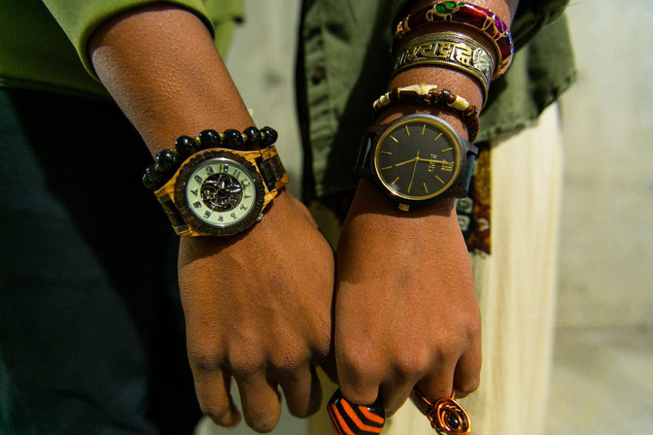 black couple holding hands wearing Jord wood watches
